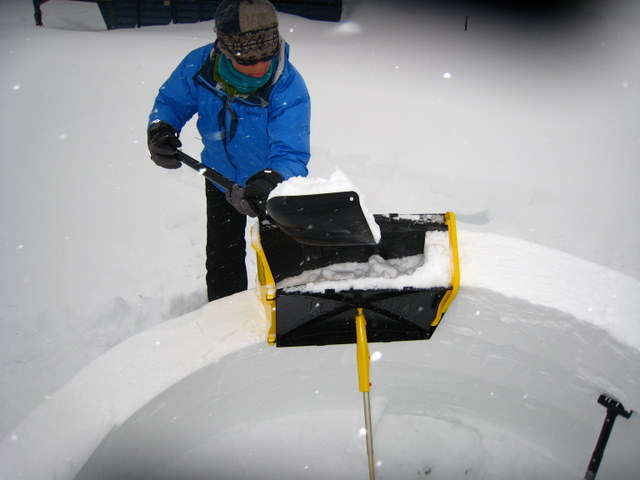Packing igloo form with snow