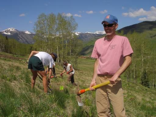 Steve Lawlor wields a pulaski