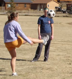 Molly showing Steph a trick she learned while playing in the Brazilian speedball league during her semester abroad.